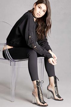 A pair of clear ankle boots featuring a lucite heel, contrast lace-up top, and an open toe. This is an independent brand and not a Forever 21 branded item.