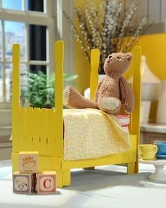 """How-To Clementine Crate Doll Bed. Recycle a clementine crate to make a cute doll bed for your little girl. This how-to from illustrator Heather Ross is inspired by her children's book """"Crafty Chloe. Doll Crafts, Diy Doll, Fun Crafts, Diy And Crafts, Paint Stir Sticks, Painted Sticks, Diy For Kids, Crafts For Kids, Kids Fun"""