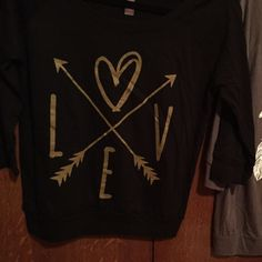 3/4 sleeve tshirt screenprinted Black 3/4 sleeve tshirt with gold screenprinted LOVE design with arrows. Tshirt brand is Bella's super soft and comfy! Buy Dreamer shirt with it for addition discount. Bella Tops Tees - Long Sleeve