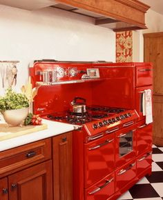 What a glorious stove! (And how great would this look in my dream kitchen, in yellow or powder blue?!?)