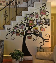 This is my family tree!  Underneath my staircase I just penciled in a tree outline that I liked.  I got this tree off the internet under tree images and just painted it black.