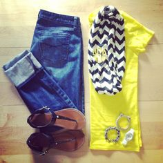 Jeans, yellow tee, brown sandals, black and white scarf
