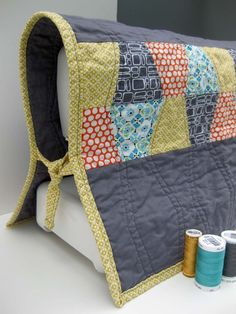 Quilted sewing machine cover--adds a touch of art to a sewing/craft room!