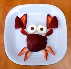 Crab made from an apple, strawberries, the site won't open so I think the eyes may be  marshmallows)