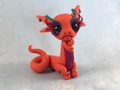 Excited to share this item from my shop: Light orange and purple polymer clay dragon Polymer Clay People, Easy Polymer Clay, Polymer Clay Disney, Polymer Clay Dragon, Polymer Clay Figures, Polymer Clay Animals, Clay Animation, Clay Monsters, Animal Crafts For Kids