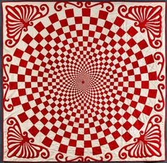 Hand crafted quilts in a red and white color scheme.