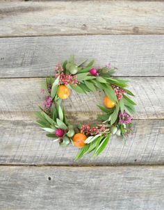 With oranges! http://www.stylemepretty.com/living/2015/08/05/diy-summer-floral-wreath/