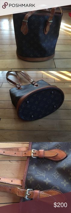 Louis Vuitton bucket purse VERY used Hold for a trade!!I traded for the purse on here and I believe that it is NOT authentic and it has been extremely loved. The canvas is in good shape but the handles are very worn. Zipper still works but inside is worn. I'm open to trade Louis Vuitton Bags Shoulder Bags