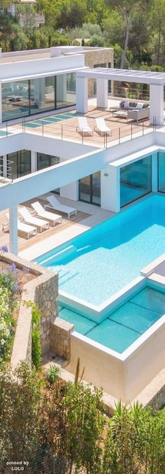 Contemporary pool house - if that's the pool house, I can't even imagine what the rest of the house looks like!