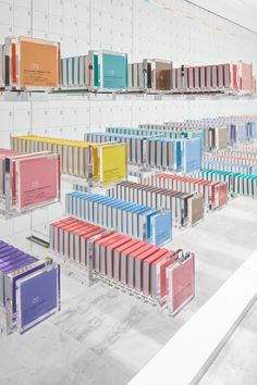 Japanese studio Nendo designed the first overseas store for BbyB chocolate shop by Antwerp-based, 2 Michelin star chef Bart Desmidt. Because the chocolates are all the same shape, the packaging is modular: five bars of chocolate slot neatly into each sliding box, and five boxes slot together into a cube. The contents become apparent only gradually, as the boxes are opened and closed, offering surprises until the very last bite and turning the cube into a 'magic chest of drawers'.