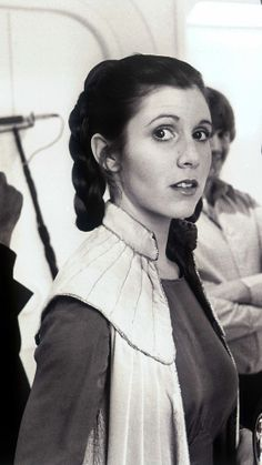 Princess Leia, hi. (I like how the guy behind her is smiling back there... who is that? Luke?)