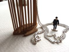 Tiny Businessman in a Dark Suit Trapped inside a Cricket Cage Statement Necklace 0304