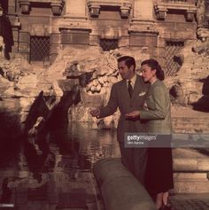January American actor Tyrone Power - with his newly-wed wife, the Mexican actress Linda Christian sightseeing in Rome. They are throwing coins into the famous Trevi Fountain, to ensure their return to the city. (Photo by Slim Aarons/Getty Images) Tyrone Power, Slim Aarons, Christian Actors, Don Ameche, Steve Guttenberg, Lloyd's Of London, Shelley Winters, Power Photos, The Sun Also Rises