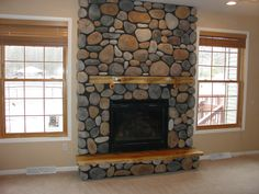 river stone fireplace designs | Adirondack style fireplace with river rock cultured stone and wood ...