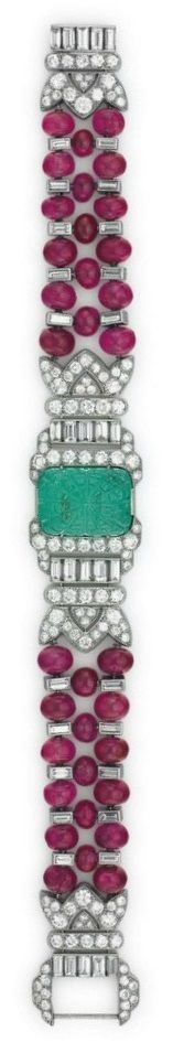 OSCAR HEYMAN & BROTHERS - AN ART DECO EMERALD, RUBY AND DIAMOND BRACELET, CIRCA 1920. Centring upon a carved cabochon emerald, old and baguette-cut diamond plaque, to the flexible three-row ruby bead band spaced by collet-set baguette-cut diamonds, joined by an old and baguette-cut diamond clasp, mounted in platinum, with maker's mark for Oscar Heyman & Brothers, numbered. #OscarHeyman #ArtDeco #bracelet