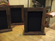 Table-top chalkboard signs for welcome table.  Double sided... i know its not the look but just an idea could make tall. wouldn't fall over