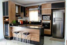 Uma bela cozinha planejada no castanho
