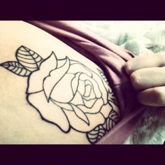 Just the outline of one of three roses. The rose is a symbol of love, but it is also a symbolic carrier of secrets and understanding.