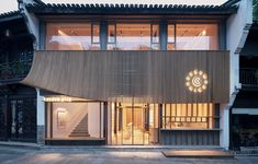 Image 1 of 30 from gallery of Random Art Space / AIR architects. Photograph by Hao Chen Timber Walls, Timber Beams, Curved Walls, Wood Walls, Facade Design, Exterior Design, Interior And Exterior, Architecture Design, Gallery Cafe