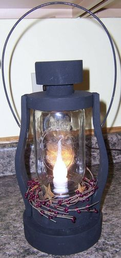 wooden hand painted lantern with pip berry wreath