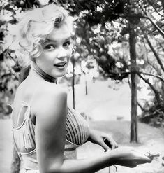 """summers-in-hollywood:  """"Marilyn Monroe in Central Park, NY, 1957. Photo taken by Sam Shaw  """""""