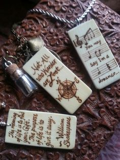 Recycled vintage ivory piano keys wood burned with philosophies to make pendants.