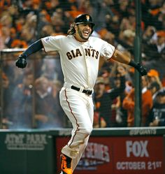 San Francisco Giants' Michael Morse (38) celebrates after hitting a solo home run to tie the game in the eighth inning of Game 5 of the National League baseball championship series against the St. Louis Cardinals at AT&T Park in San Francisco, Calif., on Thursday, Oct. 16, 2014. (Josie Lepe/Bay Area News Group)