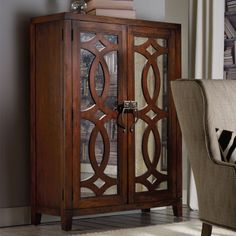 Awesome 2-drawer cabinet with 3 adjustable shelves and wine storage behind 2 mirrored doors with latticed overlay details.