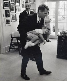 John at the White House John Fitzgerald Kennedy, Jr. playing with his uncle Robert F. Kennedy, in the Oval Office.                                                   Stock Photo ID:  0000356827-029   Date Photographed:  1963