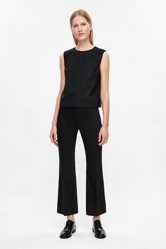 COS image 1 of Flared slim trousers in Black