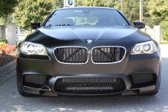 Damon Roche's 2013 BMW M5 Sedan wrapped in Frozen Black exterior.