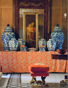 Mary McDonald-painted floor/orange Ikat fabric/blue and white porcelains tablescape