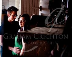 Engagement photo couple in old shed with farm machinery by Graham Crichton Photography - www.letustellyourlifestory.com