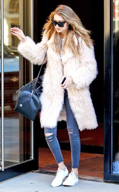 Gigi Hadid from The Big Picture: Today's Hot Pics  Leaving her New York apartment, Gigi rocks a pastel pink coat on her way to a photoshoot.
