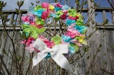 Easter wreath. → Materials: paper plate or light - weight cardboard, tissue paper, glue, and ribbon.