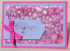 Birthday Card using SU Melon Mambo and Lovely Lilac papers, SU Spring Flowers embossing folder, SU silver embossing powder. Greeting is printed from my computer. Faux Patina Technique for the embossed paper can be found here : https://www.youtube.com/watch?v=CX-bm0dvmpw