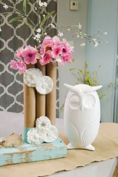 Decorating on a dime has never been easier or more fun than these super cute DIY paper towel roll vases! Mix up the colors and add some to your home decor!