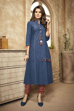 Look brilliant in this sassy blue designer suit featuring princess cut piping and resham and faux mirror accentuation on the front of torso. Comes with red printed narrow cut pants. This suit is not accompanied by matching dupatta.
