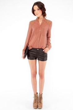 brick colored blouse. loving the pairing with leather shorts.
