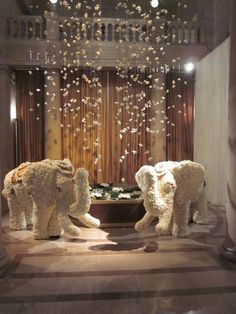 The guests were welcomed into the Thai-themed cocktail hour, by 2 carnation encrusted elephants, a shower of orchid blooms and a silver stone pond with giant water lilies.