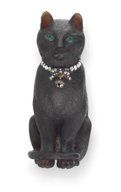 Boucheron perfume bottle, c. 1895, takes the form of a cat, carved from black chalcedony with emerald eyes, a collar made of diamonds and a gold bell.            Tags: christie's, objets d'art, van cleef & arpels    Leave a Reply  Your email address will not be published. Required fields are marked *    Name *    Email *    Website