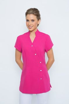 SPA 55 tunic - Hot pink. Elegant tunic with diamonte buttons. Mandarin collar, diamonte button front, cap sleeve. Buttons can be moved left to right to make this tunic smaller or larger in areas if needed. Very flattering and comfortable to wear. Buttons are diamonte custom made buttons…to add a little bling. Perfect with any of our spa pants to complete your look Sizes 6-24.