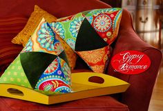 Triangle patchwork pyramid pillows. This would be a fun project to use small pieces of favorite fabrics.
