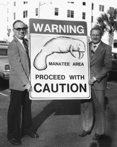 Florida Department of Natural Resources director Harmon Shields, right, and Clifford A. Willis with new manatee protection sign in Tallahassee (1970s). | Florida Memory