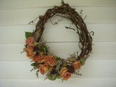 Victorian grapevine wreath decorated with dried roses and and many other beautiful dried flowers.