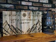 Personalized Coordinates Signs! The artwork is wood burned onto reclaimed wood. This wood wall art is a rustic mountain range combined with its own unique coordinates. Choose your favorite travel spot! #Mountainart #coordinatessigns #gpssigns #mountianrange #cabindecor #personalizedgifts #littlecottonwoodcanyon