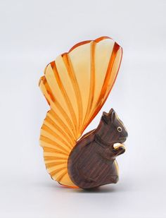 1940s Elzac carved lucite and wood squirrel brooch