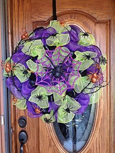 Halloween Holiday Spider Wreath - Made with Purple and Green Mesh, Black Ribbon and Orange, Black and Purple Spiders