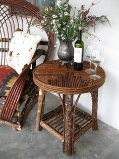 I didn't specify what kind of table!  I like this rustic furniture combined with old silver and a glass of wine. Piece is from Willow lane rustics.