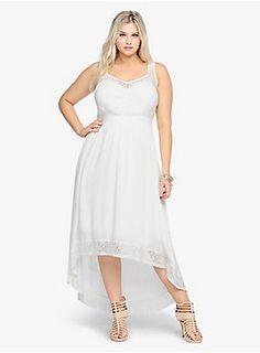 "<p>Go ahead and max out your look! Lace trim gives this ivory gauze dress a feminine vibe. This v-cut number has a shirred waistline that flatters the figure. A hi-lo hem completes this tank style in a trendy way.</p>  <p></p>  <p><b>Model is 5'9"", size 1</b></p>  <ul> <li>Size 1 measures 46"" from shoulder</li> <li>Rayon/nylon/cotton/spandex; lining: polyester</li> <li>Hand wash cold, dry flat</li> <li>Imported plus size dress</li> </ul>"